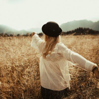 woman fields leading forward